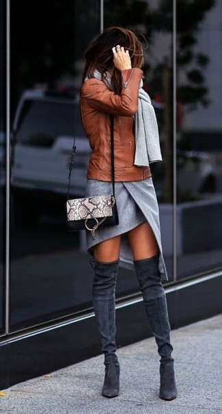 How to Wear Charcoal Suede Over The Knee Boots: This combo of a tobacco leather biker jacket and a grey slit mini skirt delivers comfort and fashion. Charcoal suede over the knee boots will take an otherwise mostly casual look in a more sophisticated direction.