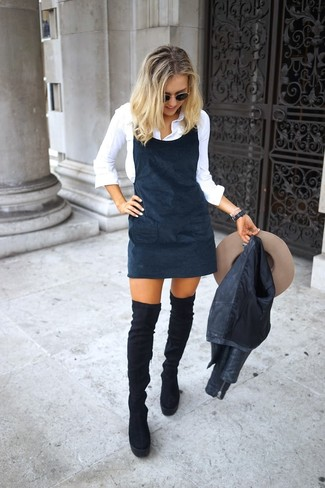 How to wear: black leather biker jacket, black overall dress, white dress shirt, black suede over the knee boots