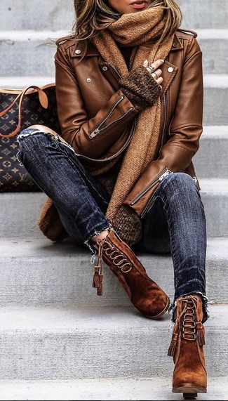 How to Wear a Brown Leather Biker Jacket For Women: A resounding yes to this laid-back pairing of a brown leather biker jacket and navy ripped skinny jeans! Avoid looking too casual by finishing off with a pair of brown suede lace-up ankle boots.