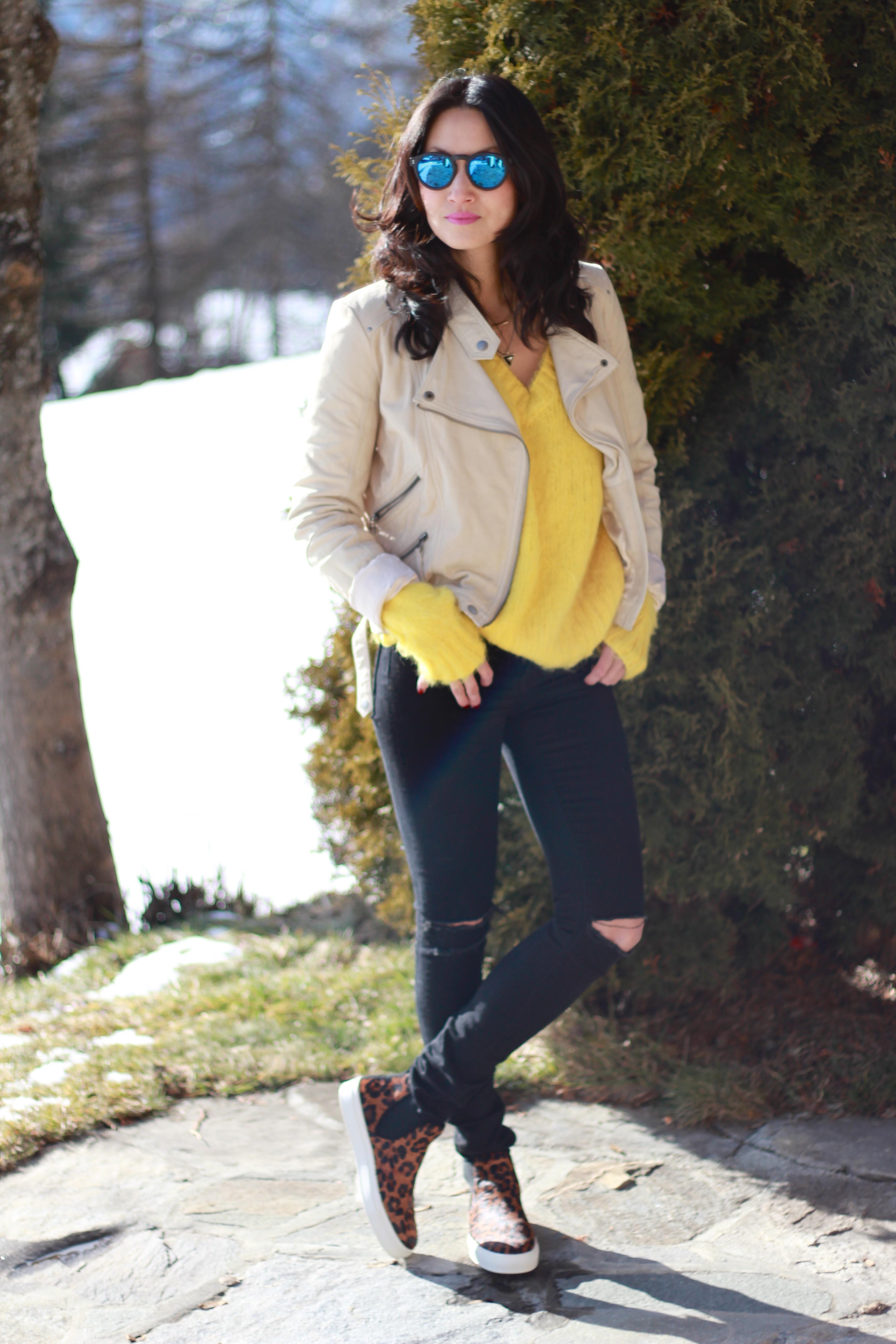 c0fd441c586e How to wear: beige leather biker jacket, yellow knit oversized sweater,  black ripped