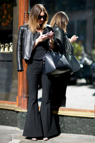 How to wear: black quilted leather biker jacket, black peplum top, black flare pants, black leather heeled sandals