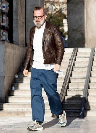 How to Wear Grey Athletic Shoes For Men: Demonstrate your chops in menswear styling in this relaxed combination of a brown leather biker jacket and navy chinos. To infuse a more casual touch into this look, add a pair of grey athletic shoes to the mix.