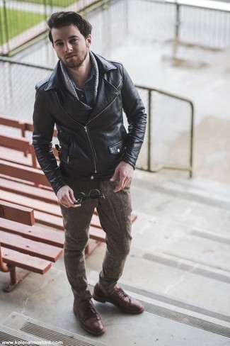 How to Wear Burgundy Leather Derby Shoes: A black leather biker jacket and brown wool chinos are a great look worth having in your daily arsenal. A pair of burgundy leather derby shoes will immediately dress up this look.