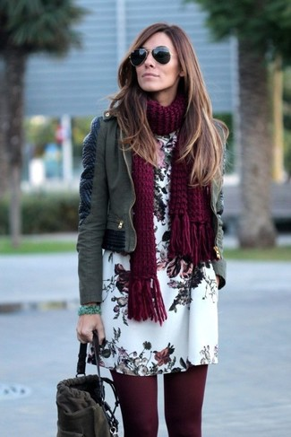 How to wear: olive leather biker jacket, white floral shift dress, charcoal suede bucket bag, burgundy knit scarf