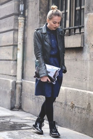 How to wear: black leather biker jacket, navy denim shirtdress, black leather lace-up flat boots, silver leather clutch