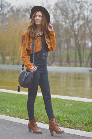 How to wear: tobacco suede biker jacket, black lace short sleeve blouse, black skinny jeans, brown leather lace-up ankle boots