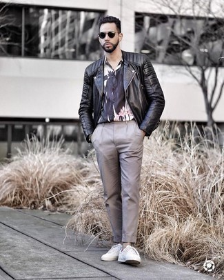 How to Wear a Black Leather Biker Jacket For Men: This off-duty pairing of a black leather biker jacket and grey chinos is a winning option when you need to look sharp in a flash. Add white canvas low top sneakers to your outfit and ta-da: the getup is complete.