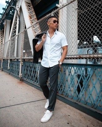 Black Leather Biker Jacket Outfits For Men: A black leather biker jacket and charcoal chinos are a nice outfit formula to have in your menswear arsenal. We're totally digging how a pair of white leather low top sneakers makes this getup complete.