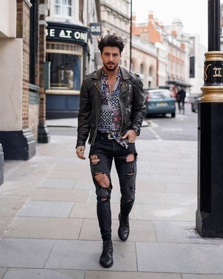 Brogue Boots Outfits: Pair a dark brown leather biker jacket with charcoal ripped skinny jeans to be both bold casual and functional. Don't know how to finish this look? Rock brogue boots to dial up the style factor.