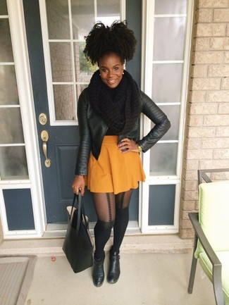 How to wear: black leather biker jacket, orange skater skirt, black leather ankle boots, black leather tote bag