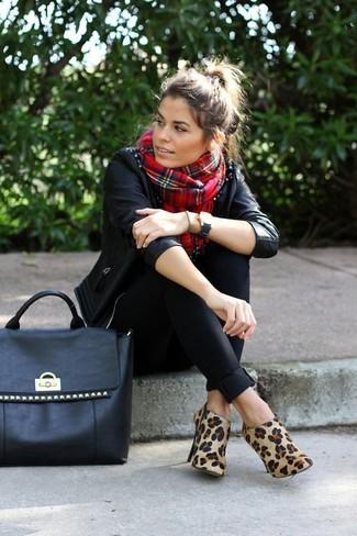 How to wear: black studded leather biker jacket, black skinny pants, tan leopard suede ankle boots, black studded leather tote bag