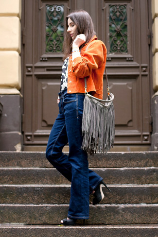 This pairing of an orange suede biker jacket and navy flare jeans is a safe bet for an effortlessly cool look. Go for a pair of PeepToe Gambas Cut Out Shoes to instantly up the chic factor of any outfit. This combo is a pretty great pick, especially for fall, when the temperature is dropping.