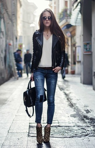 How to wear: black quilted leather biker jacket, beige sleeveless top, navy skinny jeans, tan leopard calf hair ankle boots
