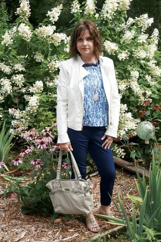 How to wear: white leather biker jacket, blue print sleeveless top, navy tapered pants, beige leather flat sandals