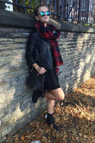 How to wear: black leather biker jacket, black sweater dress, black suede lace-up flat boots, black leather crossbody bag