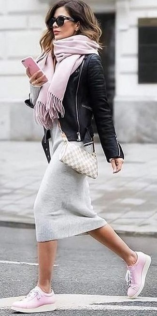 How to wear: black leather biker jacket, grey sweater dress, pink low top sneakers, beige leather crossbody bag
