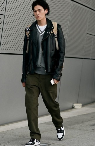 Black Leather Biker Jacket Outfits For Men: A black leather biker jacket and dark green chinos have become indispensable casual styles for most men. Not sure how to finish off? Complete your ensemble with white and black leather high top sneakers for a more casual take.