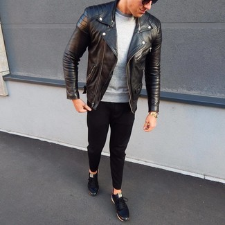 Which Shoes To Wear With Black Chinos: This casual combo of a black leather biker jacket and black chinos is super easy to pull together in no time, helping you look amazing and prepared for anything without spending a ton of time searching through your closet. We love how this whole ensemble comes together thanks to a pair of black leather low top sneakers.
