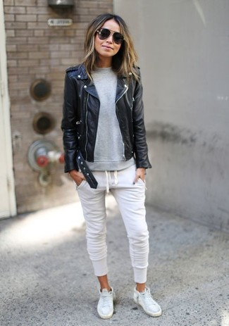 Show off your playful side in a black leather moto jacket and white track pants. Mix things up by wearing white leather high top sneakers.