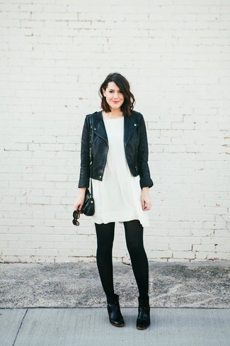 How to wear: black leather biker jacket, white swing dress, black leather chelsea boots, black leather crossbody bag
