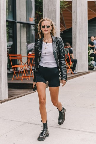 How to wear: black leather biker jacket, white tank, black bike shorts, black leather lace-up flat boots