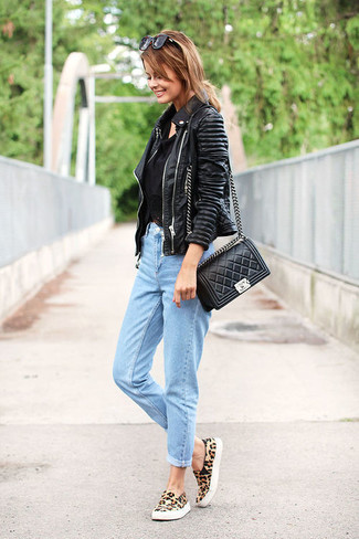 Opt for a black leather motorcycle jacket and a black crossbody bag to create a great weekend-ready look. Consider tan leopard suede low top sneakers as the glue that will bring your outfit together. This ensemble is super functional and will help you out in in-between weather.
