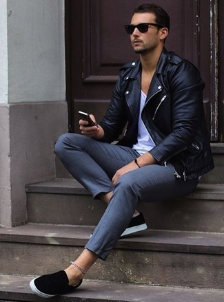 How to Wear a White Tank For Men: Dress in a white tank and grey chinos if you're looking for an outfit option that speaks casual cool. A trendy pair of black canvas slip-on sneakers is an effective way to upgrade this ensemble.