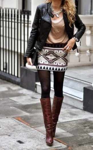 A black leather motorcycle jacket and a white geo mini skirt will give off this very sexy and chic vibe. Add dark brown leather knee high boots to your look for an instant style upgrade.