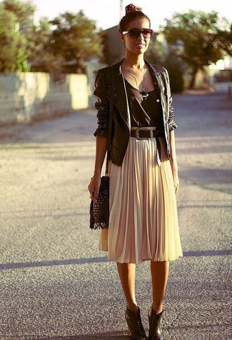 How to wear: black leather biker jacket, black tank, beige pleated midi skirt, dark brown leather wedge ankle boots