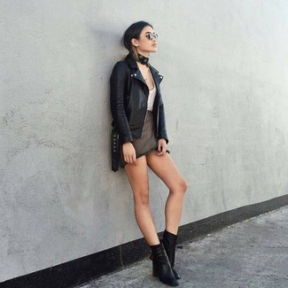 A black leather biker jacket and a charcoal mini skirt will give off this very sexy and chic vibe. Elevate your getup with black leather ankle boots.