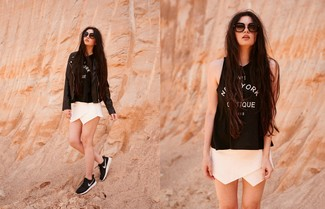 How to wear: black leather biker jacket, black and white print tank, white shorts, black and white athletic shoes