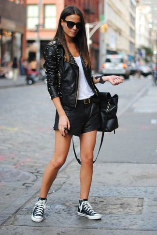 How to wear: black studded leather biker jacket, white tank, black leather shorts, black and white high top sneakers