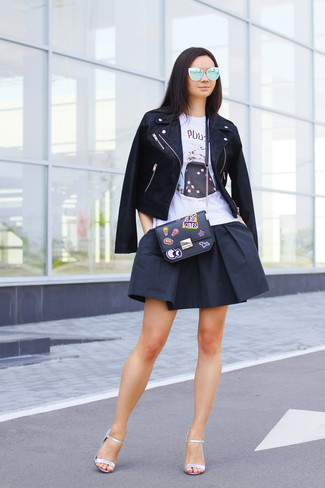Dress in a black leather biker jacket and an Alexander McQueen Skull Camera Crossbody Bag for comfort dressing from head to toe. You could perhaps get a little creative when it comes to footwear and spruce up your look with silver leather heeled sandals. A practical illustration of transitional style, this getup is ideal this spring.