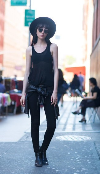 Consider wearing a black tank and black slim jeans to get a laid-back yet stylish look. A pair of black leather booties adds some real flair to this getup. As you can see, this ensemble is a really nice choice, especially for unpredictable fall weather, when the temperature is falling.