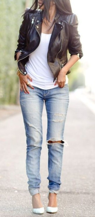Let everyone know that you know a thing or two about style in a black leather motorcycle jacket and light blue ripped skinny jeans. Why not introduce white leather pumps to the mix for an added touch of style?