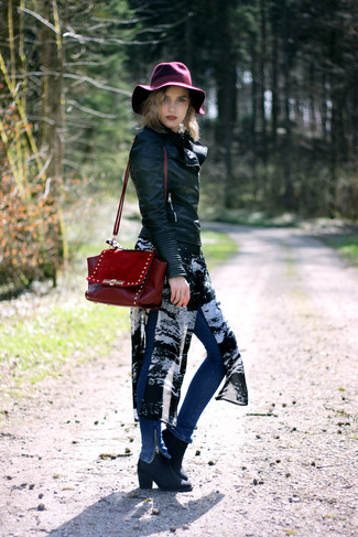 How to wear: black leather biker jacket, black and white print chiffon tunic, blue skinny jeans, black leather ankle boots