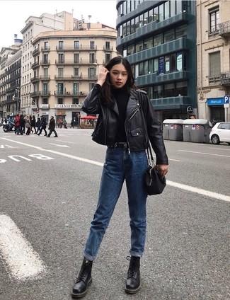 How to wear: black leather biker jacket, black turtleneck, blue boyfriend jeans, black leather lace-up flat boots