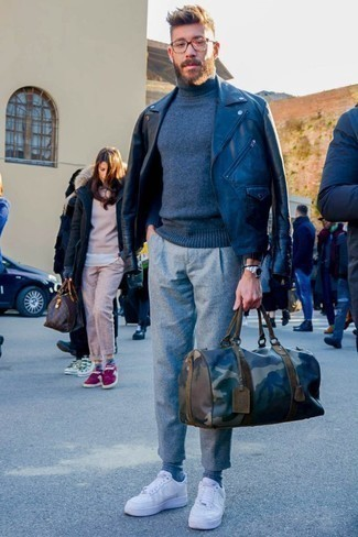 How to Wear a Holdall For Men: This pairing of a black leather biker jacket and a holdall has a easy-going and approachable vibe. And if you want to easily ramp up your ensemble with footwear, introduce a pair of white low top sneakers to the equation.