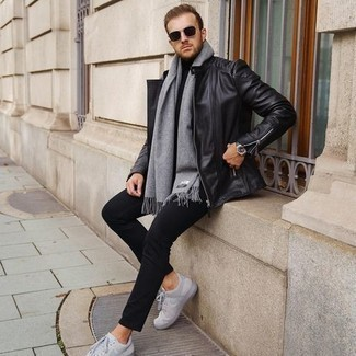 500+ Casual Outfits For Men: To achieve a casual ensemble with a clear fashion twist, try pairing a black leather biker jacket with black chinos. The whole getup comes together quite nicely if you introduce a pair of grey canvas low top sneakers to your outfit.