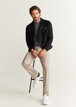 Black Biker Jacket Outfits For Men: You'll be amazed at how easy it is for any gent to put together this relaxed look. Just a black biker jacket teamed with beige chinos. If you don't know how to round off, complement your outfit with a pair of white leather low top sneakers.