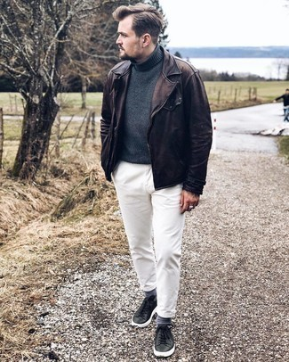 Black Leather Low Top Sneakers Outfits For Men: Want to infuse your closet with some fashion-forward cool? Marry a dark brown leather biker jacket with white chinos. Black leather low top sneakers are the glue that will tie this look together.