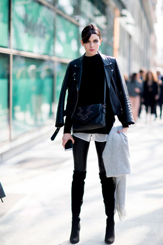 How to wear: black leather biker jacket, black turtleneck, white silk dress shirt, black leather leggings