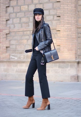How to wear: black leather biker jacket, black turtleneck, black flare pants, brown suede ankle boots