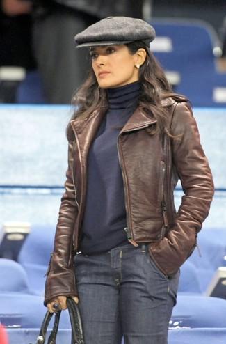 How to wear: brown leather biker jacket, navy turtleneck, navy jeans, black leather tote bag