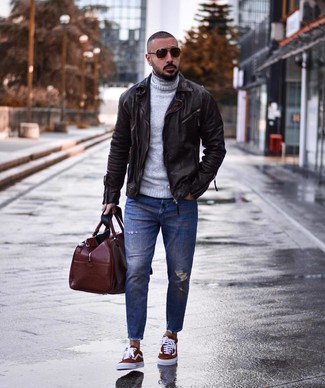 How to Wear a Brown Holdall For Men: This casual pairing of a dark brown leather biker jacket and a brown holdall is extremely versatile and apt for whatever the day throws at you. Want to play it up on the shoe front? Complete this getup with burgundy canvas low top sneakers.