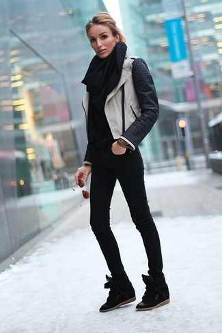 How to wear: black and white leather biker jacket, black turtleneck, black skinny jeans, black suede wedge sneakers