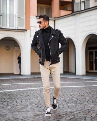 Black Biker Jacket Outfits For Men: Choose a black biker jacket and beige skinny jeans for a laid-back twist on casual urban fashion. To bring out a sophisticated side of you, complete your look with dark brown canvas low top sneakers.