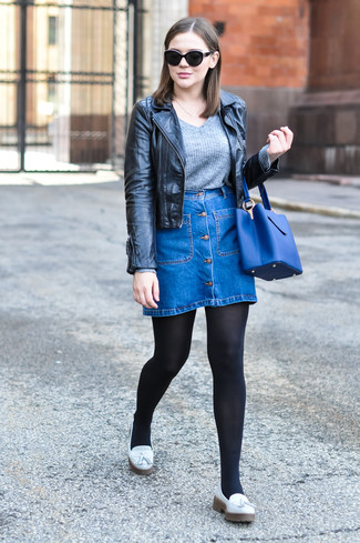 Stand out among other stylish civilians in a black leather moto jacket and a blue denim button skirt. Why not introduce white leather tassel loafers to the mix for an added touch of style? This combo is absolutely great to welcome the springtime.