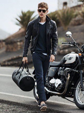 How to wear: black leather biker jacket, navy v-neck sweater, white crew-neck t-shirt, navy skinny jeans