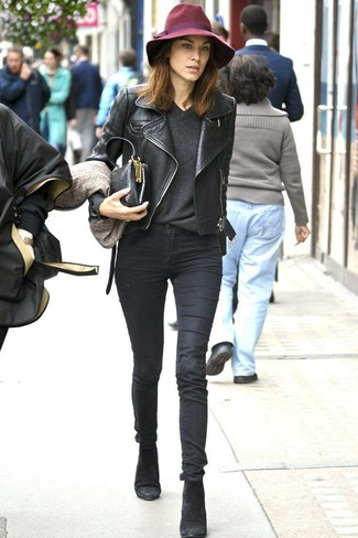 Alexa Chung wearing Black Leather Biker Jacket, Charcoal V-neck Sweater, Black Skinny Jeans, Black Suede Ankle Boots